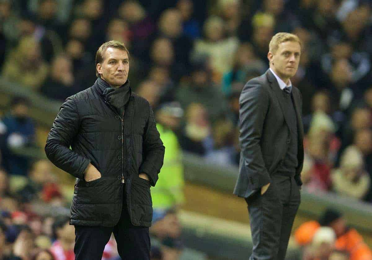 LIVERPOOL, ENGLAND - Monday, December 29, 2014: Liverpool's manager Brendan Rodgers and Swansea City's manager Garry Monk during the Premier League match at Anfield. (Pic by David Rawcliffe/Propaganda)