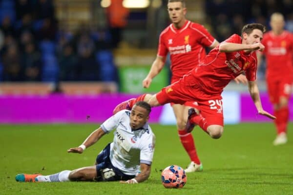 BOLTON, ENGLAND - Wednesday February 4, 2015: Liverpool's Joe Allen is fouled by Bolton Wanderers Neil Danns, who was subsequently sent off, during the FA Cup 4th Round Replay game at Reebok Stadium.  (Image by David Rawcliffe / Propaganda)