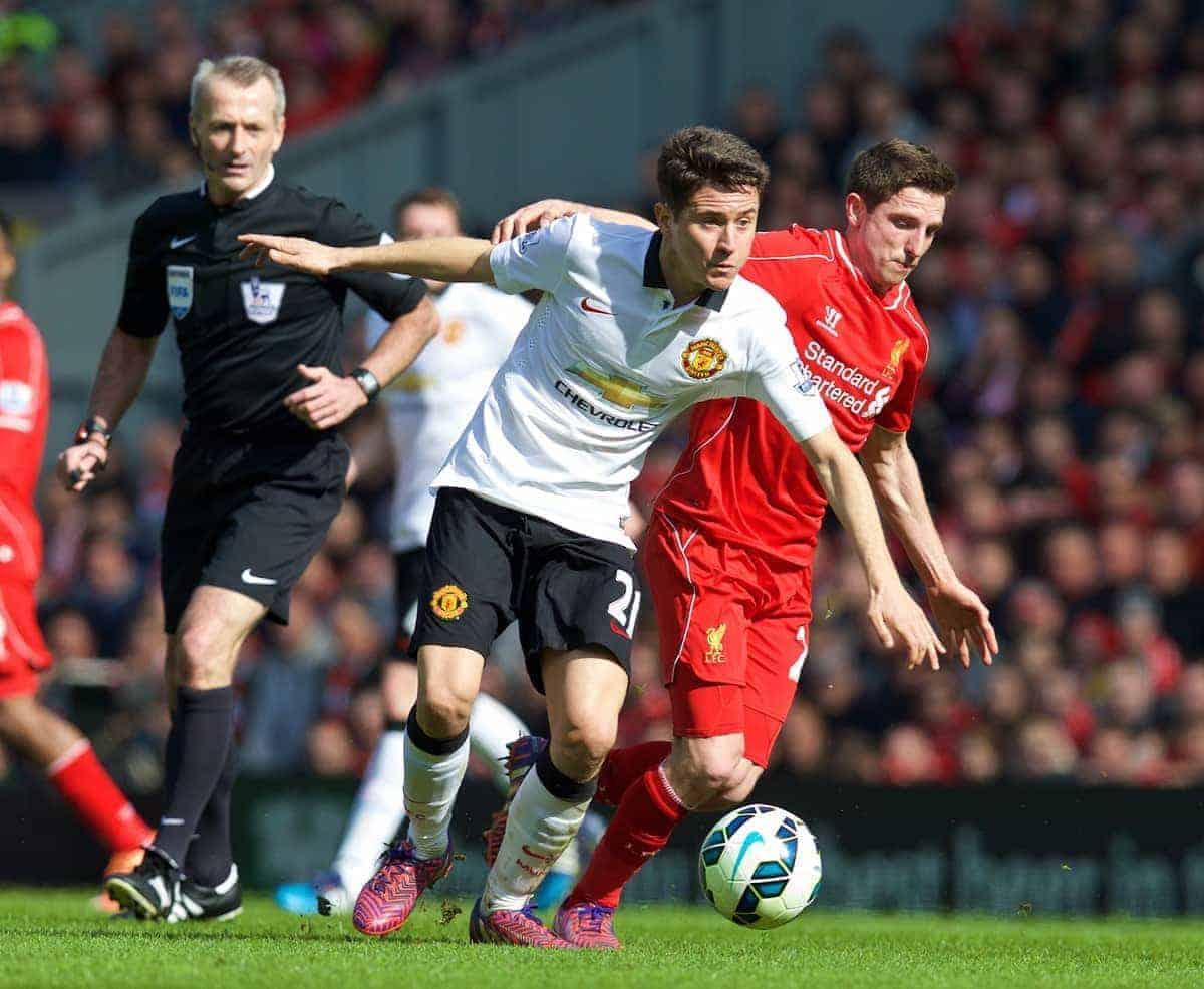 LIVERPOOL, ENGLAND - Sunday, March 22, 2015: Liverpool's Joe Allen barely touches Manchester United's Ander Herrera, who goes down heavily, the Liverpool player is then shown a yellow card by referee Martin Atkinson during the Premier League match at Anfield. (Pic by David Rawcliffe/Propaganda)