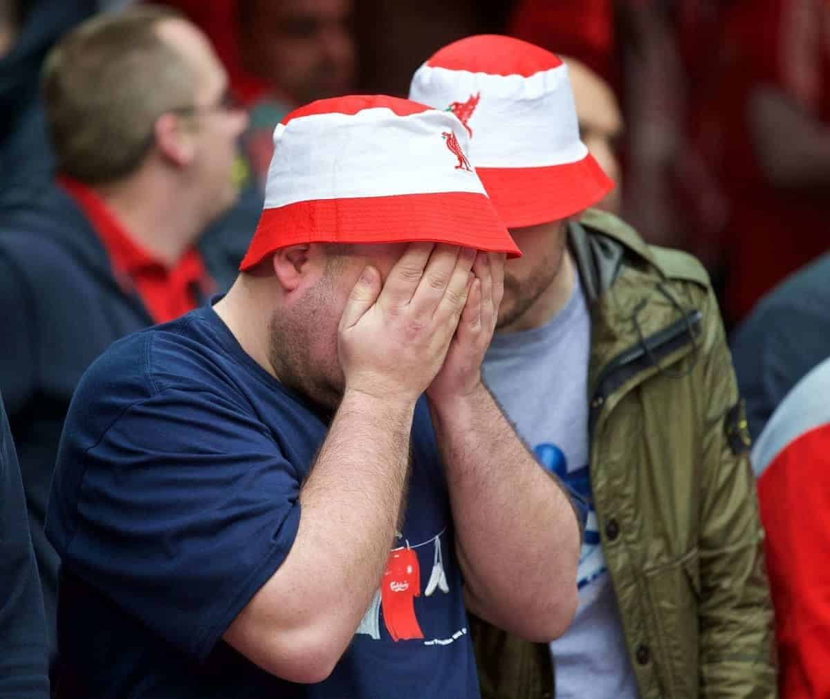 LONDON, ENGLAND - Sunday, April 19, 2015: A Liverpool supporter looks dejected during the FA Cup Semi-Final match against Aston Villa at Wembley Stadium. (Pic by David Rawcliffe/Propaganda)