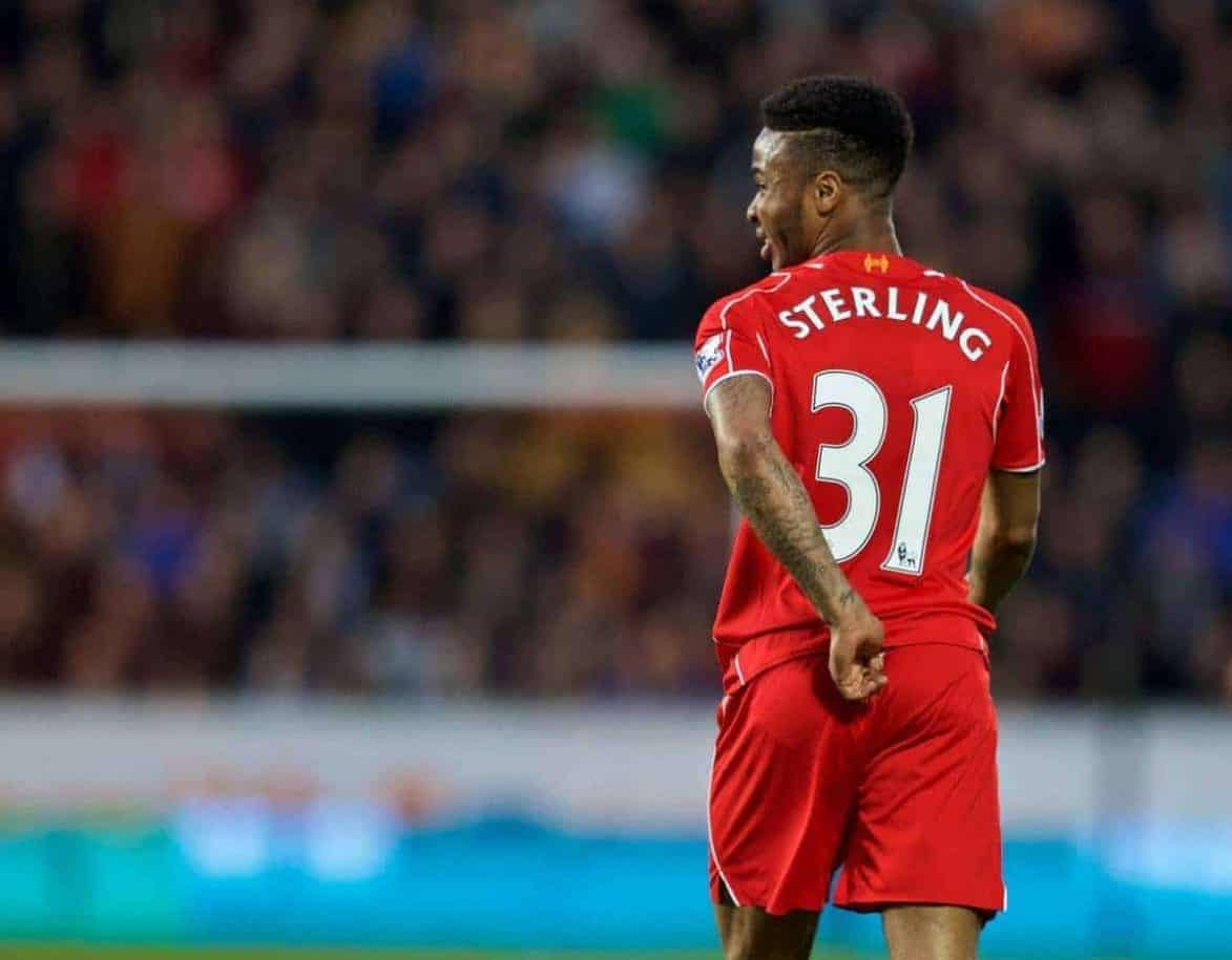 KINGSTON-UPON-HULL, ENGLAND - Tuesday, April 28, 2015: Liverpool's Raheem Sterling feels a pain in his back against Hull City during the Premier League match at the KC Stadium. (Pic by Gareth Jones/Propaganda)