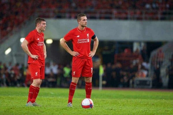 KUALA LUMPUR, MALAYSIA - Friday, July 24, 2015: Liverpool's James Milner and captain Jordan Henderson in action against a Malaysia XI during a friendly match at the Bukit Jalil National Stadium on day twelve of the club's preseason tour. (Pic by David Rawcliffe/Propaganda)