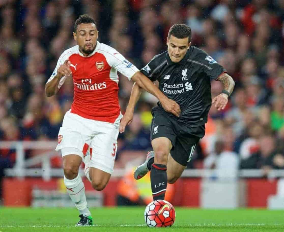 LONDON, ENGLAND - Monday, August 24, 2015: Liverpool's Roberto Firmino in action against Arsenal's Kieran Gibbs during the Premier League match at the Emirates Stadium. (Pic by David Rawcliffe/Propaganda)