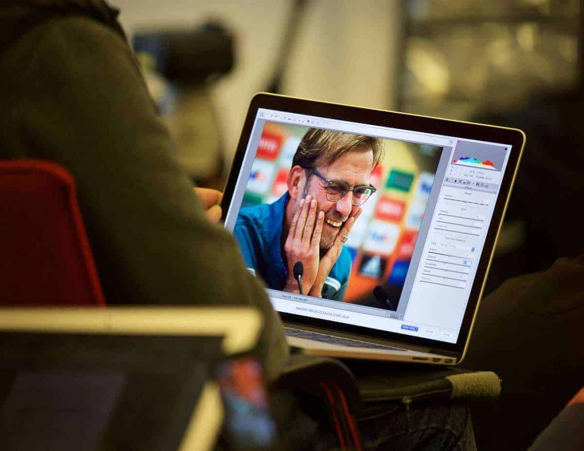 LIVERPOOL, ENGLAND - Wednesday, October 21, 2015: A photographer edits a photograph of Liverpool's manager Jürgen Klopp in Adobe Camera RAW on an Apple MacBook Pro during a press conference at Melwood Training Ground ahead of the UEFA Europa League Group Stage Group B match against FC Rubin Kazan. (Pic by David Rawcliffe/Propaganda)