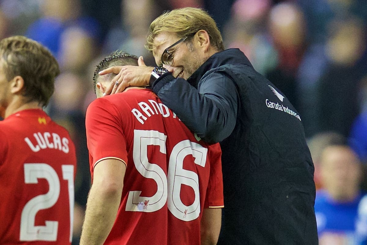 LIVERPOOL, ENGLAND - Wednesday, October 28, 2015: Liverpool's manager Jürgen Klopp embraces Connor Randall after sealing his first win, beating AFC Bournemouth 1-0, during the Football League Cup 4th Round match at Anfield. (Pic by David Rawcliffe/Propaganda)