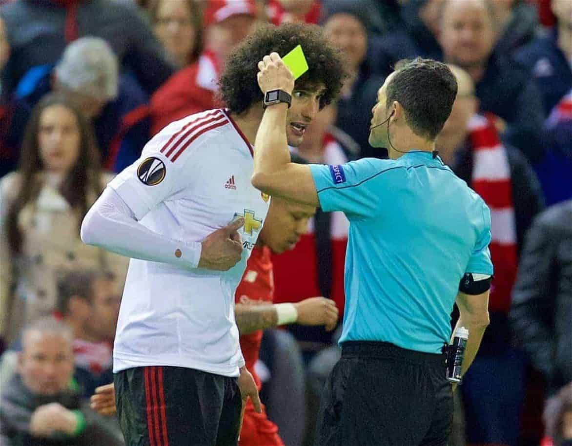 LIVERPOOL, ENGLAND - Thursday, March 10, 2016: Manchester United's Marouane Fellaini is shown a yellow card by referee Carlos Velasco Carballo during the UEFA Europa League Round of 16 1st Leg match at Anfield. (Pic by David Rawcliffe/Propaganda)