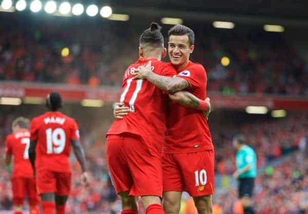 Liverpool's Philippe Coutinho Correia celebrates scoring the fourth goal against Hull City with team-mate Roberto Firmino during the FA Premier League match at Anfield. (Pic by David Rawcliffe/Propaganda)