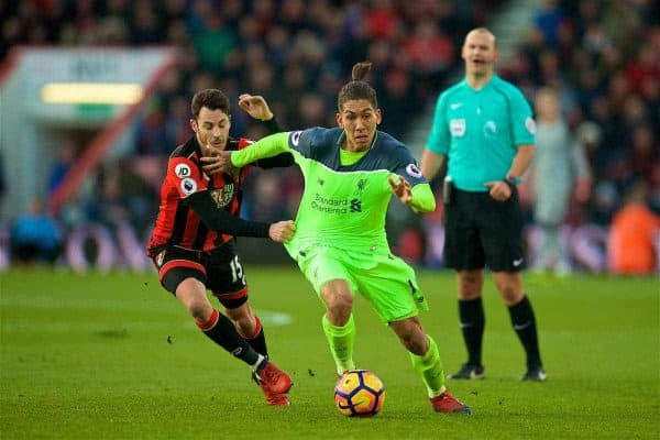 BOURNEMOUTH, ENGLAND - Sunday, December 4, 2016: Liverpool's Roberto Firmino in action against AFC Bournemouth's Adam Smith during the FA Premier League match at Dean Court. (Pic by David Rawcliffe/Propaganda)