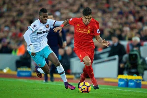 LIVERPOOL, ENGLAND - Sunday, December 11, 2016: Liverpool's Roberto Firmino in action against West Ham United's Enner Valencia during the FA Premier League match at Anfield. (Pic by David Rawcliffe/Propaganda)