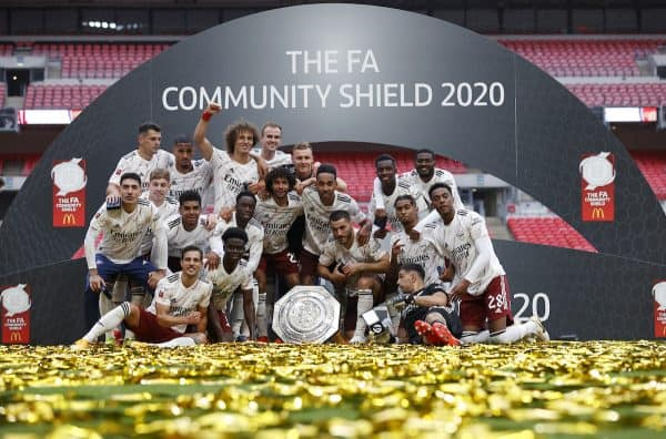 LONDON, ENGLAND - Saturday, August 29, 2020: Arsenal players celebrate with the trophy after winning a penalty shoot-out against Liverpool following a 1-1 draw during the FA Community Shield match between FA Premier League Champions Liverpool FC and FA Cup Winners Arsenal FC. The game was played behind closed doors. Arsenal won 5-4 on penalties. (Credit: Eddie Keogh/The FA)