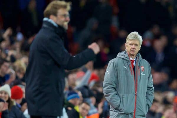 LIVERPOOL, ENGLAND - Saturday, March 4, 2017: Arsenal's manager Arsene Wenger looks on as Liverpool's manager Jürgen Klopp celebrates the third goal during the FA Premier League match at Anfield. (Pic by David Rawcliffe/Propaganda)
