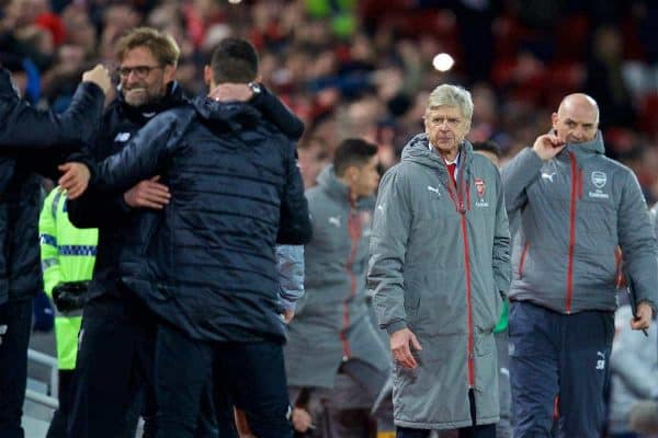 LIVERPOOL, ENGLAND - Saturday, March 4, 2017: Arsenal's manager Arsene Wenger waits to shake hands as Liverpool's manager Jürgen Klopp celebrates the 3-1 victory with his staff during the FA Premier League match at Anfield. (Pic by David Rawcliffe/Propaganda)