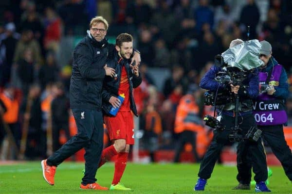 Liverpool's manager Jürgen Klopp celebrates the 3-1 victory with Adam Lallana after the FA Premier League match against Arsenal at Anfield. (Pic by David Rawcliffe/Propaganda)