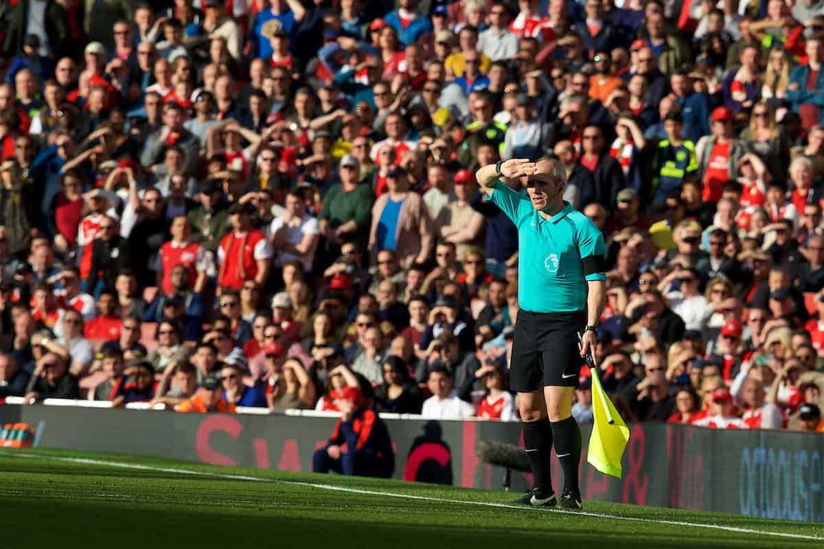 LONDON, ENGLAND - Sunday, April 2, 2017: Assistant linesman shields his eyes from the sun during the FA Premier League match between Arsenal and Manchester City at the Emirates Stadium. (Pic by David Rawcliffe/Propaganda)
