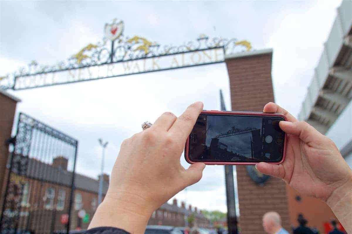 LIVERPOOL, ENGLAND - Sunday, May 21, 2017: A supporter take a photo of the Liverpool club crest above the Shankly gates outside Anfield ahead of the FA Premier League match between Liverpool and Middlesbrough. (Pic by David Rawcliffe/Propaganda)