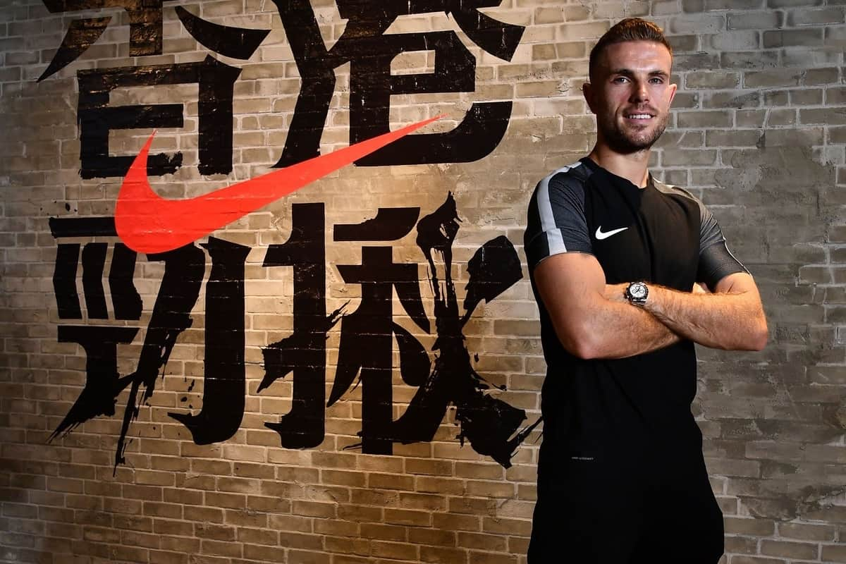 HONG KONG, CHINA - Wednesday, July 19, 2017: Liverpool's captain Jordan Henderson poses for a photo next to the Hong Kong Fight wall at a new Nike store in the Mong Kok district of Hong Hong. (Pic by Pool/Nike/Propaganda)