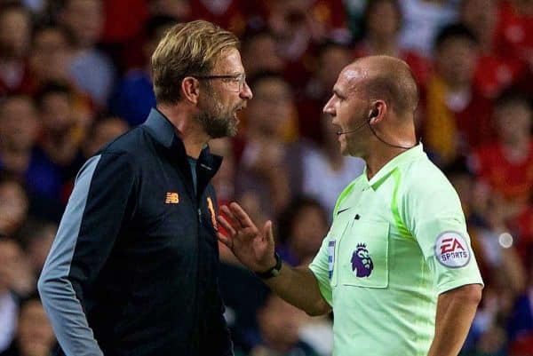 HONG KONG, CHINA - Saturday, July 22, 2017: Liverpool's manager J¸rgen Klopp is spoken to by referee Bobby Madley during the Premier League Asia Trophy final match between Liverpool and Leicester City at the Hong Kong International Stadium. (Pic by David Rawcliffe/Propaganda)
