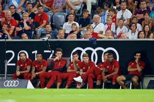 MUNICH, GERMANY - Wednesday, August 2, 2017: Liverpool's unused players Danny Ings, Nathaniel Clyne, goalkeeper Kamil Grabara, Philippe Coutinho Correia, Alberto Moreno, Dejan Lovren, Daniel Sturridge and Mohamed Salah sit on the sidelines during the Audi Cup 2017 final match between Liverpool FC and Atlético de Madrid's at the Allianz Arena. (Pic by David Rawcliffe/Propaganda)