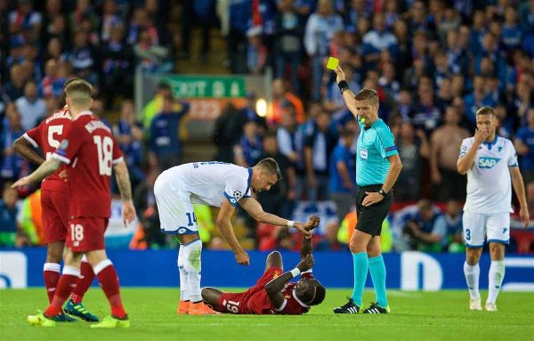 LIVERPOOL, ENGLAND - Wednesday, August 23, 2017: TSG 1899 Hoffenheim's Sandro Wagner is shown a yellow card by referee Daniele Orsato for a foul on Liverpool's Sadio Mane during the UEFA Champions League Play-Off 2nd Leg match between Liverpool and TSG 1899 Hoffenheim at Anfield. (Pic by David Rawcliffe/Propaganda)