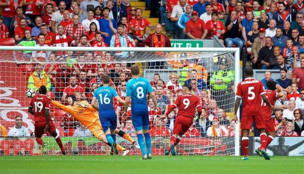 LIVERPOOL, ENGLAND - Sunday, August 27, 2017: Liverpool's Roberto Firmino scores the first goal during the FA Premier League match between Liverpool and Arsenal at Anfield. (Pic by David Rawcliffe/Propaganda)
