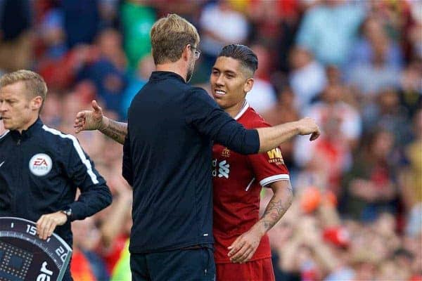 LIVERPOOL, ENGLAND - Sunday, August 27, 2017: Liverpool's manager Jürgen Klopp embraces Roberto Firmino after he substitutes him during the FA Premier League match between Liverpool and Arsenal at Anfield. (Pic by David Rawcliffe/Propaganda)