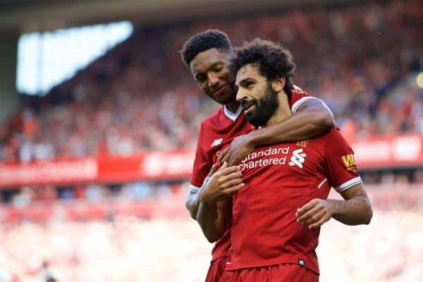 Liverpool's Mohamed Salah celebrates scoring the third goal with team-mate Joe Gomez during the FA Premier League match between Liverpool and Arsenal at Anfield. (Pic by David Rawcliffe/Propaganda)