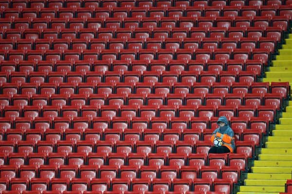 LIVERPOOL, ENGLAND - Friday, September 22, 2017: A steward acts as a ball boy sitting in empty red seats during the Under-23 FA Premier League 2 Division 1 match between Liverpool and Tottenham Hotspur at Anfield. (Pic by David Rawcliffe/Propaganda)