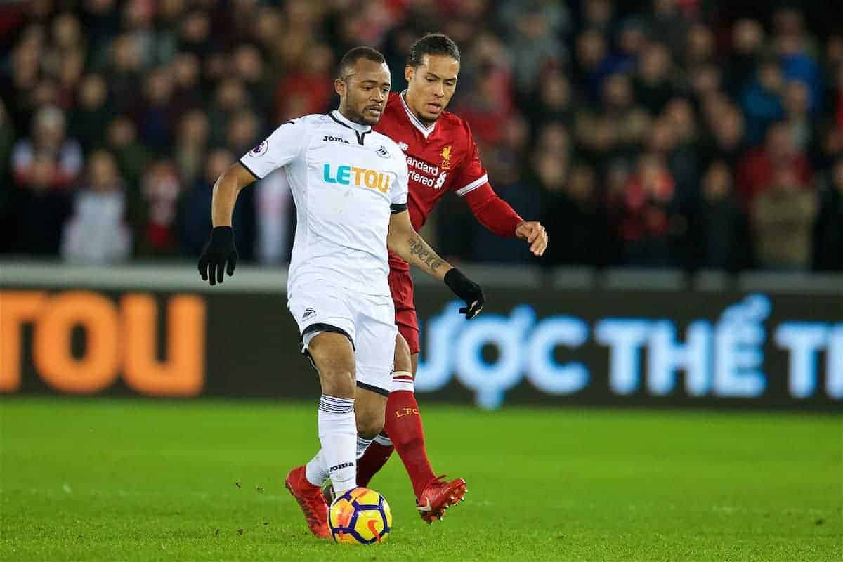 SWANSEA, WALES - Monday, January 22, 2018: Swansea City's Jordan Ayew and Liverpool's Virgil van Dijk during the FA Premier League match between Swansea City FC and Liverpool FC at the Liberty Stadium. (Pic by David Rawcliffe/Propaganda)