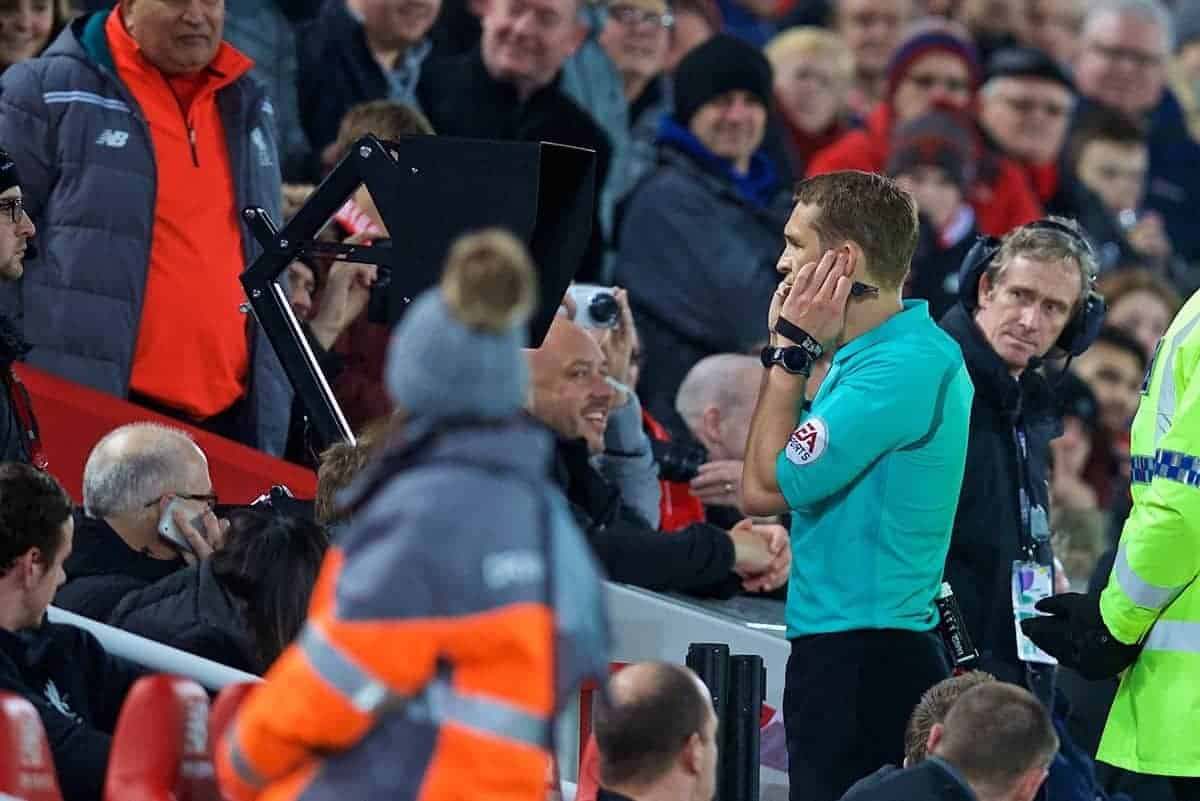 LIVERPOOL, ENGLAND - Sunday, January 14, 2018: Referee Craig Pawson studies a pitch-side television monitor as he reviews a foul before awarding Liverpool a penalty using VAR during the FA Premier League match between Liverpool and Manchester City at Anfield. (Pic by David Rawcliffe/Propaganda)