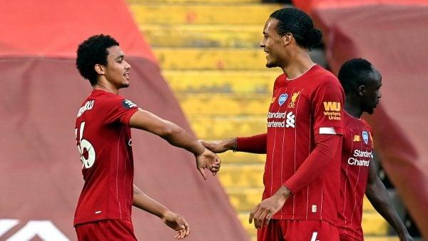 Liverpool's Trent Alexander-Arnold celebrates with Virgil Van Dijk (Paul Ellis/NMC Pool/PA)