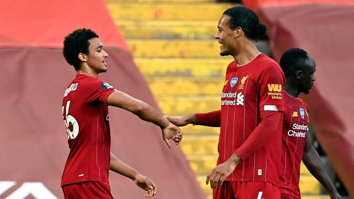 Liverpool's Trent Alexander-Arnold celebrates with Virgil Van Dijk (Paul Ellis/NMC Pool/PA)