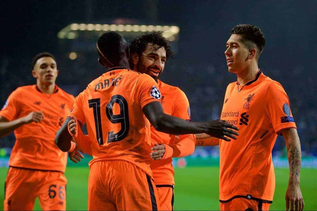 """PORTO, PORTUGAL - Wednesday, February 14, 2018: Liverpool's Sadio Mane celebrates scoring the third goal with team-mates Mohamed Salah and Roberto Firmino during the UEFA Champions League Round of 16 1st leg match between FC Porto and Liverpool FC on Valentine's Day at the Est·dio do Drag""""o. (Pic by David Rawcliffe/Propaganda)"""