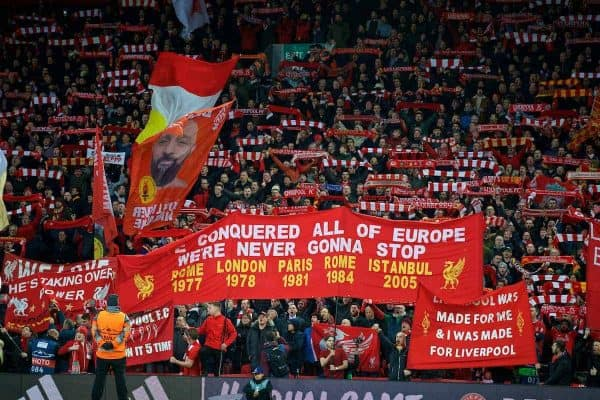 """Liverpool supporters on the Spion Kop hold up scarves as they sing """"You'll Never Walk Alone"""" during the UEFA Champions League Quarter-Final 1st Leg match between Liverpool FC and Manchester City FC at Anfield. (Pic by David Rawcliffe/Propaganda)"""