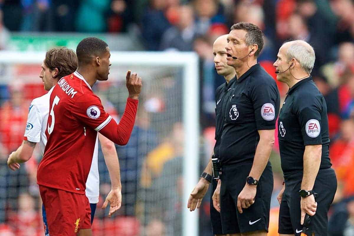 LIVERPOOL, ENGLAND - Saturday, April 28, 2018: Liverpool's Georginio Wijnaldum speaks with referee Andre Marriner and assistant referee Richard West after the goal-less draw during the FA Premier League match between Liverpool FC and Stoke City FC at Anfield. (Pic by David Rawcliffe/Propaganda)