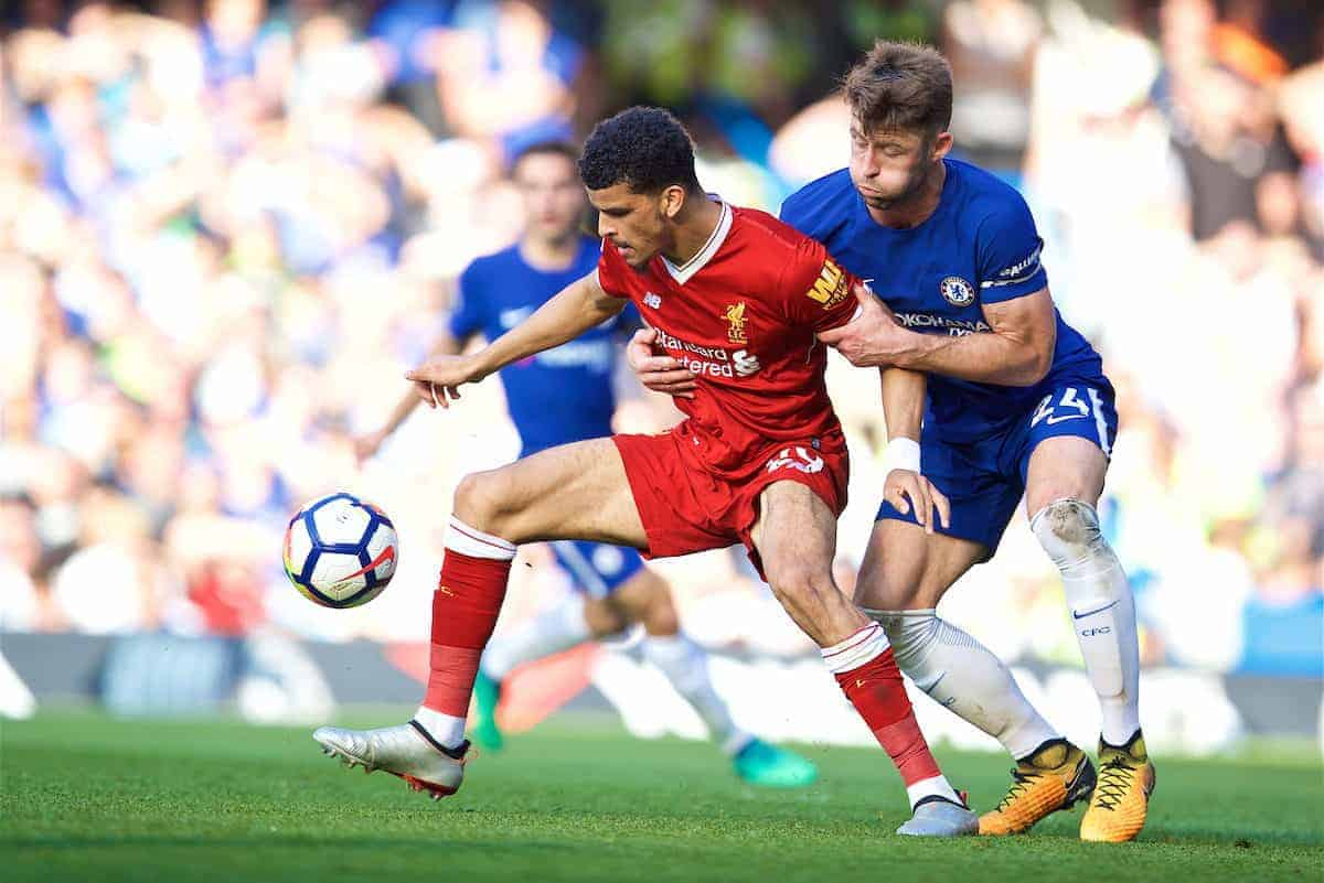 LONDON, ENGLAND - Sunday, May 6, 2018: Liverpool's Dominic Solanke and Chelsea's Gary Cahill during the FA Premier League match between Chelsea FC and Liverpool FC at Stamford Bridge. (Pic by David Rawcliffe/Propaganda)