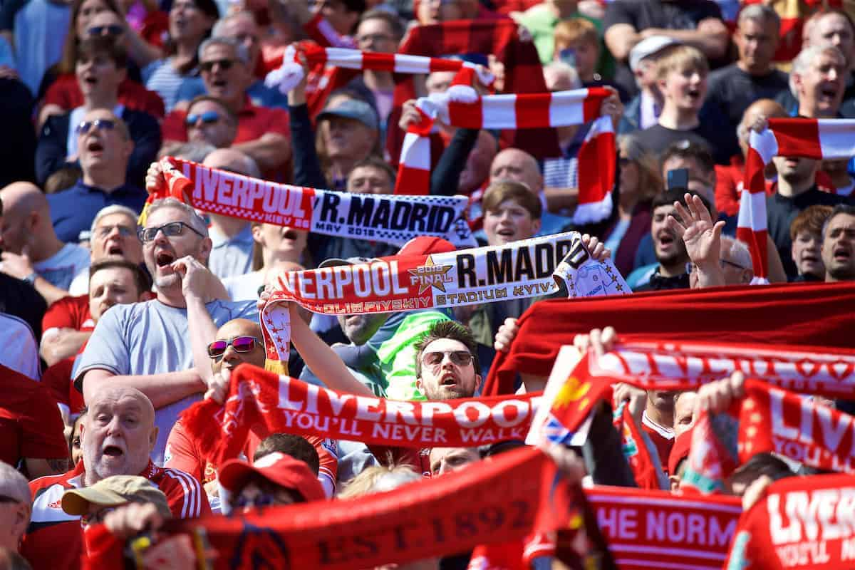 "LIVERPOOL, ENGLAND - Sunday, May 13, 2018: Liverpool supporters sing ""You'll Never Walk Alone"" with Real Madrid half and half scarves during the FA Premier League match between Liverpool FC and Brighton & Hove Albion FC at Anfield. (Pic by David Rawcliffe/Propaganda)"