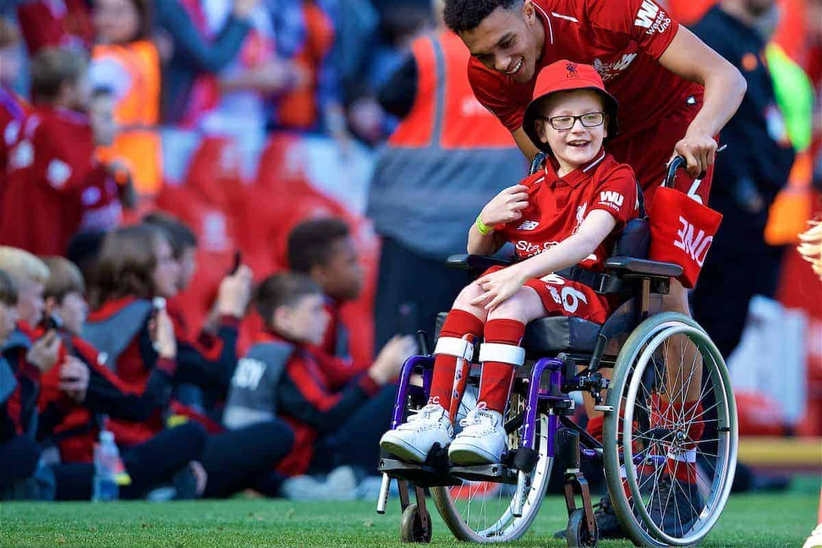 LIVERPOOL, ENGLAND - Sunday, May 13, 2018: Liverpool's Trent Alexander-Arnold pushes a wheelchair with young supporter Louis as the players perform a lap of honour after the FA Premier League match between Liverpool FC and Brighton & Hove Albion FC at Anfield. Liverpool won 4-0 and finished 4th. (Pic by David Rawcliffe/Propaganda)