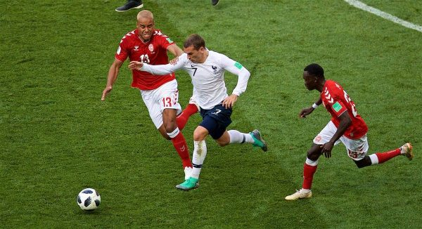 MOSCOW, RUSSIA - Tuesday, June 26, 2018: France's Antoine Griezmann gets away from Denmark's Mathias Jorgensen (left) and Pione Sisto (right) during the FIFA World Cup Russia 2018 Group C match between Denmark and France at the Luzhniki Stadium. (Pic by David Rawcliffe/Propaganda)