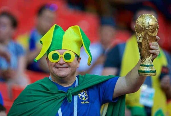 MOSCOW, RUSSIA - Wednesday, June 27, 2018: A Brazil supporter wearing novelty green and yellow sunglasses and a jester hat holds a replica World Cup trophy during the FIFA World Cup Russia 2018 Group E match between Serbia and Brazil at the Spartak Stadium. (Pic by David Rawcliffe/Propaganda)