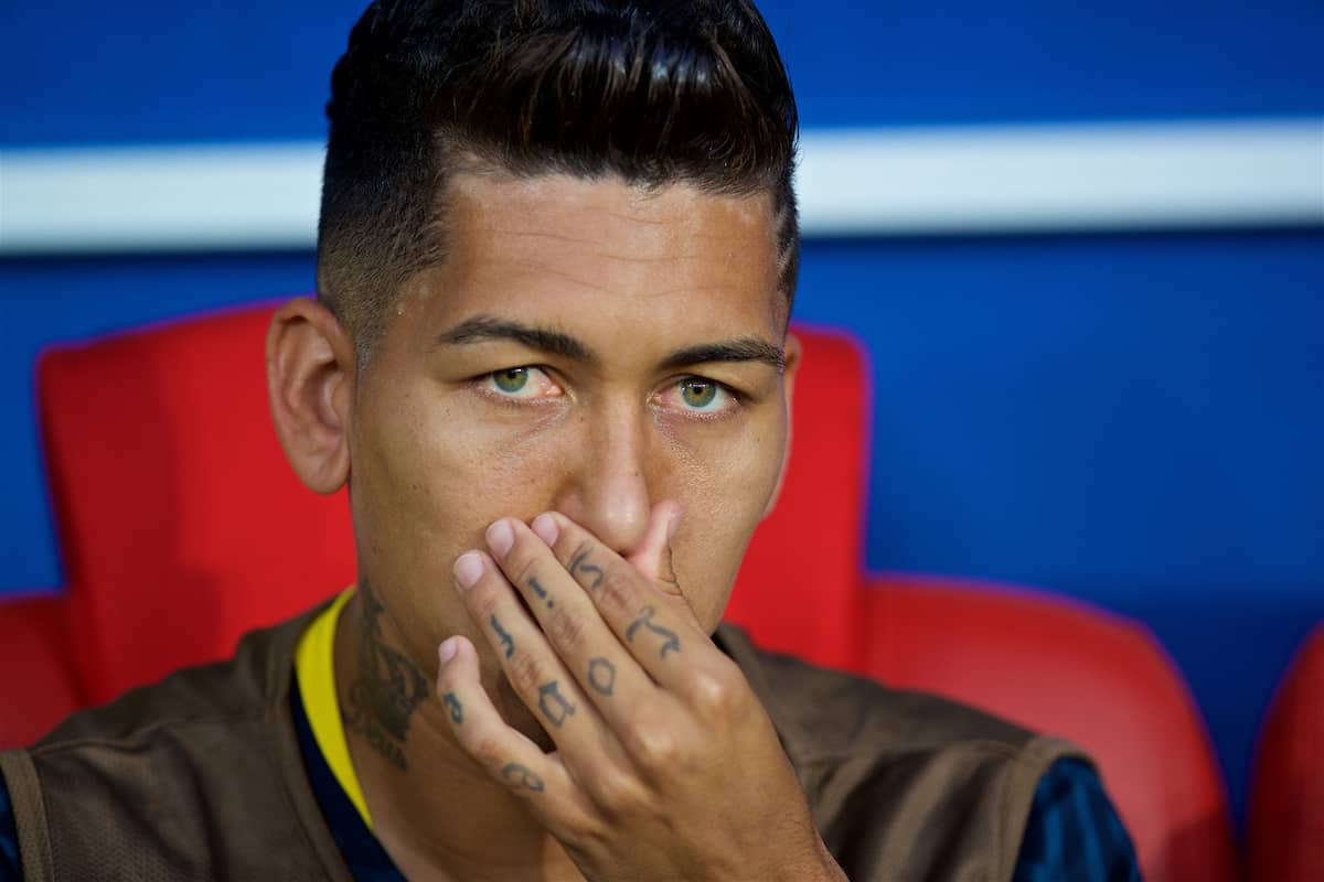 MOSCOW, RUSSIA - Wednesday, June 27, 2018: Brazil's unused substitute Roberto Firmino, with a tattoo 'Love Life' on the fingers of his left hand, on the bench before the FIFA World Cup Russia 2018 Group E match between Serbia and Brazil at the Spartak Stadium. Brazil won 2-0. (Pic by David Rawcliffe/Propaganda)