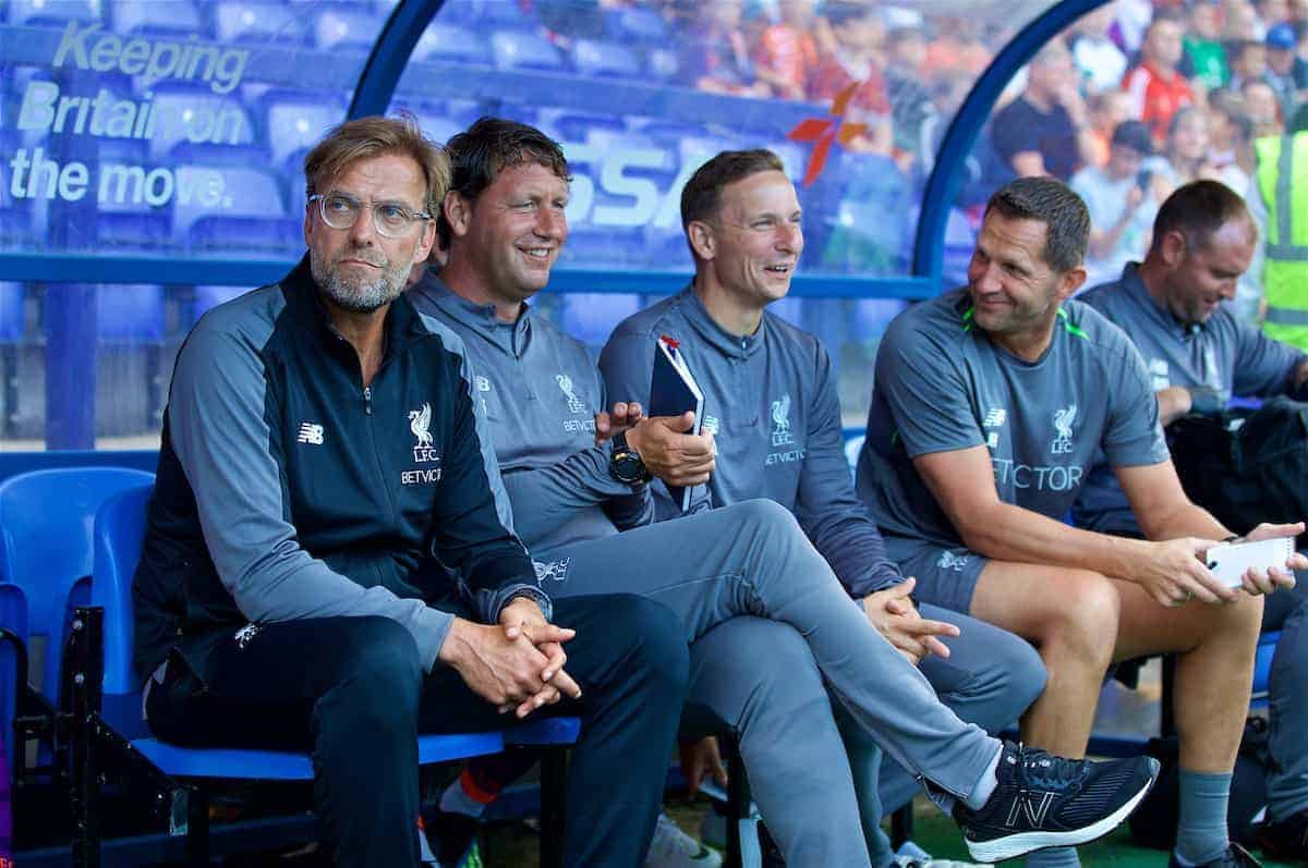 BIRKENHEAD, ENGLAND - Tuesday, July 10, 2018: Liverpool's manager J¸rgen Klopp sits on the bench with his staff first team coach Peter Krawietz, first-team development coach Pepijn Lijnders, goalkeeping coach John Achterberg before a preseason friendly match between Tranmere Rovers FC and Liverpool FC at Prenton Park. (Pic by Paul Greenwood/Propaganda)