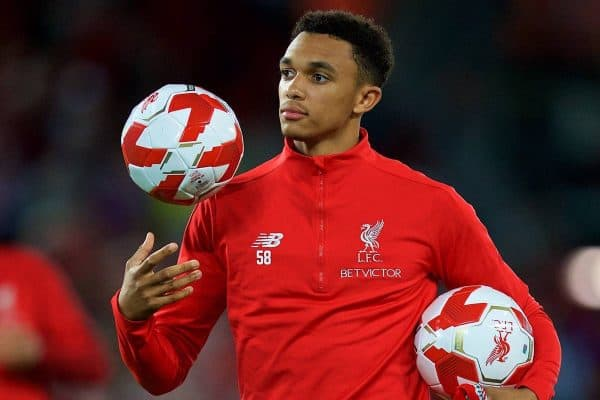 LIVERPOOL, ENGLAND - Tuesday, August 7, 2018: Liverpool's Trent Alexander-Arnold hands out balls and scarves top supporters after the preseason friendly match between Liverpool FC and Torino FC at Anfield. (Pic by David Rawcliffe/Propaganda)