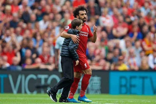 LIVERPOOL, ENGLAND - Sunday, August 12, 2018: A young Liverpool supporter runs onto the field to hug Mohamed Salah during the FA Premier League match between Liverpool FC and West Ham United FC at Anfield. (Pic by David Rawcliffe/Propaganda)