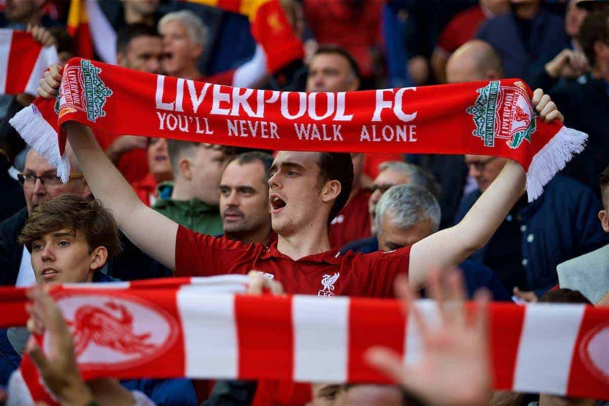 "LIVERPOOL, ENGLAND - Saturday, August 25, 2018: A Liverpool supporter holds his scarf up as he sings ""You'll Never Walk Alone"" during the FA Premier League match between Liverpool FC and Brighton & Hove Albion FC at Anfield. (Pic by David Rawcliffe/Propaganda)"