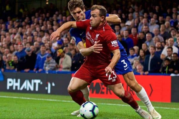 LONDON, ENGLAND - Saturday, September 29, 2018: Chelsea's Marcos Alonso (left) and Liverpool's Xherdan Shaqiri during the FA Premier League match between Chelsea FC and Liverpool FC at Stamford Bridge. (Pic by David Rawcliffe/Propaganda)