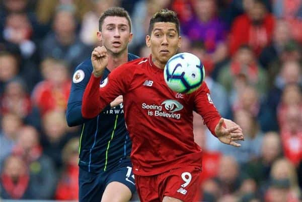 LIVERPOOL, ENGLAND - Sunday, October 7, 2018: Liverpool's Roberto Firmino (R) and Manchester City's Aymeric Laporte during the FA Premier League match between Liverpool FC and Manchester City FC at Anfield. (Pic by David Rawcliffe/Propaganda)