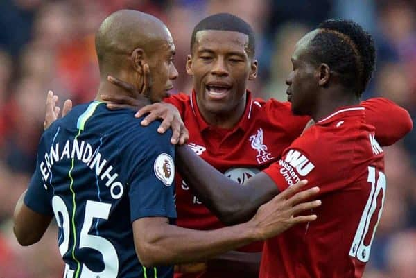 LIVERPOOL, ENGLAND - Sunday, October 7, 2018: Liverpool's Georginio Wijnaldum (C) separates Sadio Mane (R) and Manchester City's Fernando Luiz Roza 'Fernandinho' (L) during the FA Premier League match between Liverpool FC and Manchester City FC at Anfield. (Pic by David Rawcliffe/Propaganda)