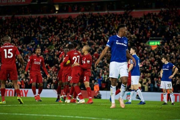 LIVERPOOL, ENGLAND - Sunday, December 2, 2018: Liverpool's Divock Origi (#27) celebrates with team-mates Georginio Wijnaldum (L), Sadio Mane (C) and Fabio Henrique Tavares 'Fabinho' (R) after his winning goal deep into injury time during the FA Premier League match between Liverpool FC and Everton FC at Anfield, the 232nd Merseyside Derby. Liverpool won 1-0. (Pic by Paul Greenwood/Propaganda)