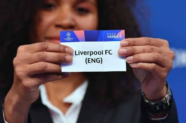 NYON, SWITZERLAND - Monday, December 17, 2018: Lyon player Laura Georges holds up Liverpool FC after making the draw during the UEFA Champions League 2018/19 Round of 16 draw at the UEFA House of European Football. (Handout by UEFA)