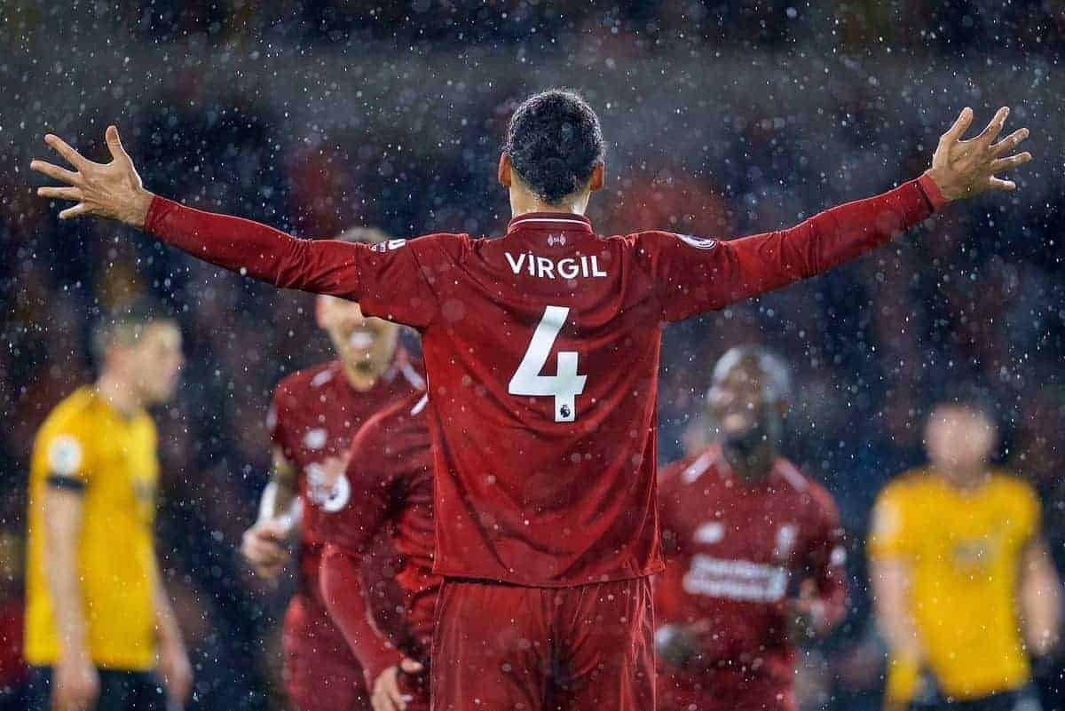 WOLVERHAMPTON, ENGLAND - Friday, December 21, 2018: Liverpool's Virgil van Dijk celebrates the first goal scored by Mohamed Salah (hidden) during the FA Premier League match between Wolverhampton Wanderers FC and Liverpool FC at Molineux Stadium. (Pic by David Rawcliffe/Propaganda)